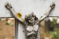 Cross Detail with Christ in a cemetery Stock Photos