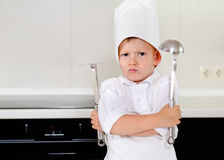 Cross determined little boy chef Stock Images