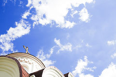 Cross on the dome of a church against the blue sky Stock Photo