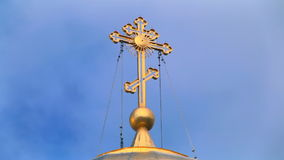 Cross on the dome of the church against the sky stock video