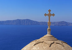 Cross on dome of church in Fira Royalty Free Stock Image