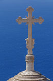 Cross on dome of church in Fira Stock Photography