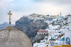 Cross on dome of church in Fira town on Santorini. View of fira town and cross on dome of church on Santorini Royalty Free Stock Photos