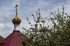 The cross and dome of the Orthodox chapel. Stock Photo