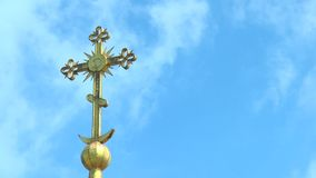 The cross on the dome of an orthodox temple against the sky with clouds stock video
