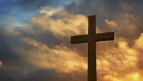 Cross With Dramatic Sky At Sunset. Dramatic silhouette of cross with golden evening sky stock footage