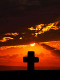 Cross at dramatic sunset  Royalty Free Stock Photo