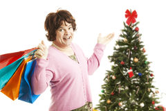 Cross Dresser - Christmas Shopping Spree. Man dressed as woman going on a Christmas shopping spree, holding bags.  Isolated on white Royalty Free Stock Images