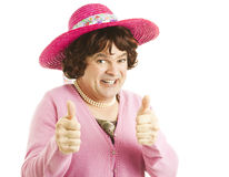 Cross Dresser Two Thumbs Up. Funny image of a man, dressed as a woman, giving two thumbs up.  Isolated on white Royalty Free Stock Image