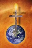 The Cross and the Earth. Cross of Christ with flame above the Earth.  (Image of earth used with permission from the NASA website Royalty Free Stock Photos