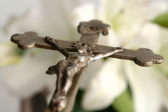Cross and easter lilies. Old cross on white easter lilies background Stock Image