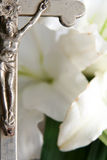 Cross and easter lilies royalty free stock image