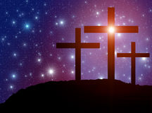 Cross Easter Stars. Jesus' cross on the Calvary hill as a  symbol of Jesus Christ, God, Resurrection, Christianity and Easter concept with starry sky at the Royalty Free Stock Photos