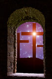 Cross Easter Stars. Jesus` cross on the Calvary hill with sky filled by twinkling sparkling stars as a  symbol of Christianity end Easter concept wisible through Royalty Free Stock Images