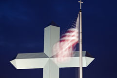Cross in Effingham with an American flag Royalty Free Stock Photo
