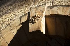 Cross on Keystone. A cross embossment on an arc keystone above the entrance to a monestary in the old city of Jerusalem royalty free stock photography