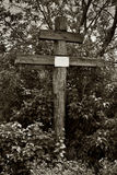 Cross with an empty nameplate. Abandoned cemetery in a russian vilage Stock Photos