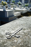 Cross engraved in a tombstone Stock Photography