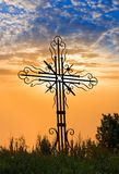 Cross on a evening sky background Stock Image