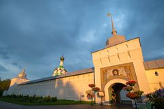 Cross-Exaltation Church In the Tolga convent. Gold ring. Yaroslavl. Russia. Monastery wall illuminated by sunset royalty free stock image