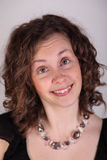 Cross eyed. Funny, cross eyed woman with curly hair stock photography