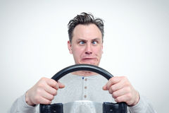Cross-eyed funny man driver with steering wheel Royalty Free Stock Images