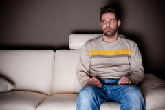 A cross-eyed man trying to watch TV Royalty Free Stock Photography