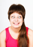 Cross eyed squinting expression girl Royalty Free Stock Image