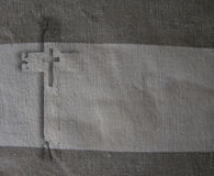 Cross on fabric Stock Photo