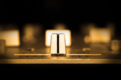 Cross-fade on DJ mixer. Closeup of the cross-fade control on a DJ mixer with sepia tone; focus on control with shallow depth of field Royalty Free Stock Photo