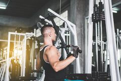 Cross fit body and muscular in the gym,Strong and handsome man doing exercises training stock photos