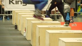 Cross Fit event, jumping on box. Close up footage of people jumping on box at Cross Fit event stock video