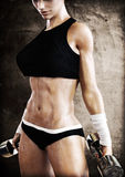 Cross fit female with a candid pose with weights after a strenuous workout. Stock Images