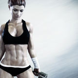 Cross fit female with a candid pose with weights after a strenuous workout Stock Images