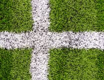 Cross flag seen on field markings on a football Royalty Free Stock Photography