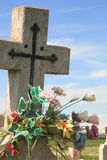 Cross with Flowers. Detail of headstone with bouquet of flowers Stock Images
