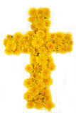 Cross of Flowers. A Christian cross made of yellow dandelion flowers on a white background Royalty Free Stock Photography