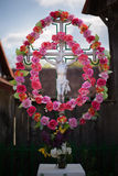 Cross with flowers. Decorated cross in Romanian village Stock Photos
