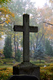 Cross in fog. At the cemetery stock photography