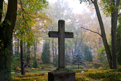Cross in fog. At the cemetery royalty free stock image