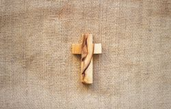 The cross of forgotten Christ Jesus is next to the river. Fisherman sails past the cross Royalty Free Stock Images