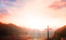 The cross of forgotten Christ Jesus is next to the river stock photography