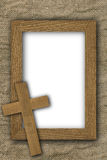 Cross and frame on old canvas Royalty Free Stock Image