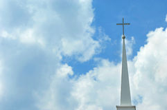 Cross framed by clouds Stock Photography