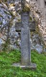 Cross in Front of Bran Castle Royalty Free Stock Photo