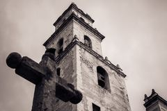 Cross in front of the steeple of the Merida Cathedral, Yucatan, royalty free stock photos