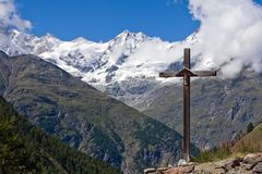 Cross in front of Weisshorn Stock Images