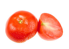 Cross and full ripe red tomatoes with dew Stock Image