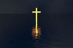 Cross glowing in night water reflection. Isolated cross rise over lake or ocean. Glow in the dark. Religious background. Metaphor for God power against darkness Stock Photography