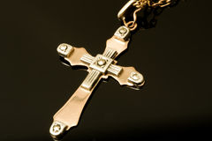Cross of gold and platinum Stock Photo